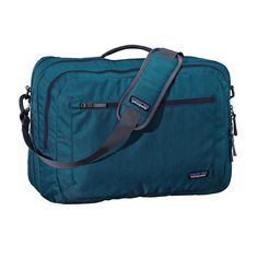 The Patagonia Transport Shoulder Bag 26L is a soft-sided suitcase made with recycled fabric. Holds most 15˝ laptops and meets airline carry-on requirements.