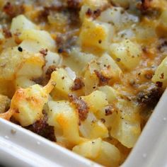 Cheesy Potato Breakfast Casserole Recipe... I might substitute the sausage for bacon or ham :)
