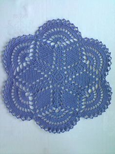 A quick doily (15 rounds mainly worked in tr). The pattern is written in US Crochet terminology.