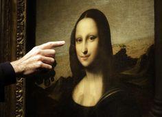 Professor Alessandro Vezzosi, Director of the Museo Ideale Leonardo da Vinci, points to details on a painting attributed to Leonardo da Vinci and representing Mona Lisa during a presentation in Geneva, Switzerland. (Reuters)