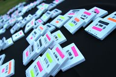 Wedding place cards: '80s rock mixed cassettes labeled with the CLASSIC old-school ribbon labels with each person's name and table assignment!