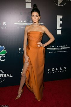 Doing a Jolie! Kendall seemed to be imitating Angelina's famous pose in the split dres