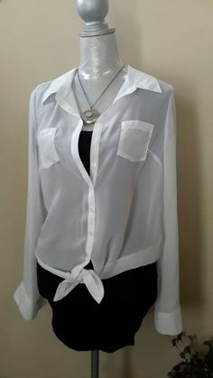 Versatile sheer white top that ties at waistline in front. Button cuffs and small pockets in front. Like new,never worn. Size large (11-13). $9.00 *OR* Antiqued pendant necklace. $9.00 See LOTS more items for sale on Poshmark @yumabridal