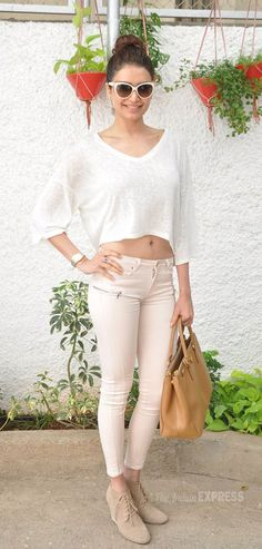 Karishma Tanna showed off her toned midriff in a white blouse and pale pink cropped skinnys at a theatre to catch a special screening of Heropanti. #Style #Bollywood #Fashion #Beauty