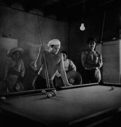 Marlon Brando and Anthony Quinn playing pool during a break from filming Viva Zapata!, Texas, 1951  by Sam Shaw