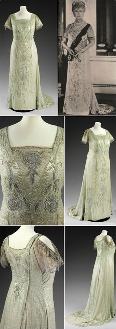 Court dress, worn by H.M. Queen Mary, made c. 1934, at the Victoria and Albert Museum. Blue net gown with short train, cut full to hang straight, back-fastening, with a short train. Pink silk lining. Floral embroidery with cross-over effect on bodice running down the front and around the train. She is seen wearing the same gown in official silver jubilee portraits from 1935 (see black-and-white image, taken from vintage postcard published by Tuck, courtesy Petworth Postcards on ebay).