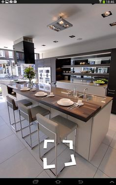 Poggenpohl kitchen, sand grey base units. Spekva wooden worktop on island. Sheen showroom.