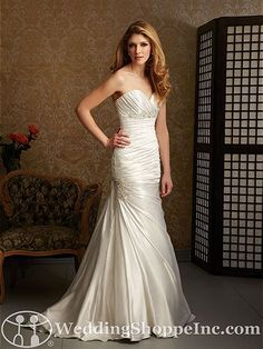 Allure Bridal Gown 2464 Fit and flare styled dress with ruching throughout the bodice and waistline