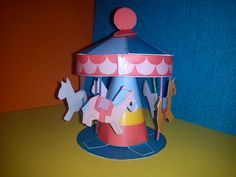This is our paper-craft carousel we have made from a free printable pattern.