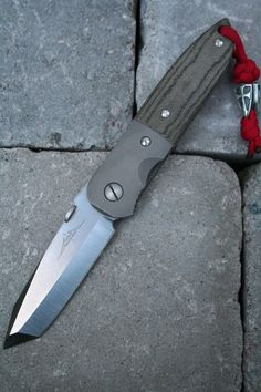 Emerson CQC-6, grail blade, right down to the Steel Flame bead.