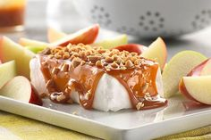 Cream cheese, caramel sauce and crunchy peanuts come together in this scrumptious dessert spread.  Don't forget the apples - that's what pulls this Caramel Apple-Cream Cheese Spread all together.