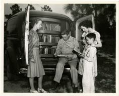 Cumberland County bookmobile. North Carolina Work Projects Administration Library Project showing rear of bookmobile with group of people reading :: Library History Collection, State Library of North Carolina http://digital.ncdcr.gov/cdm/ref/collection/p249901coll36/id/280