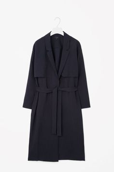 eb78b0bc This trench coat inspired blazer is made from a lightweight fluid material  with laser-cut details. Relaxed proportions, it has dropped shoulders, ...