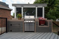 This client's rotted old deck needed a fresh new look and a serious safety upgrade.  We created a multi-level haven with cooking and lounging areas, accented with cool contemporary metal privacy screens!  Designed and built by Paul Lafrance Design.