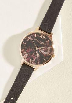 It's a given that this Olivia Burton Painterly Prints watch is workday chic, but you better believe it's also late night lovely! Its black floral face boasts a polished rose gold rim, and paired with its black leather band, this classy-meets-feminine timepiece is one worth flaunting at all times.