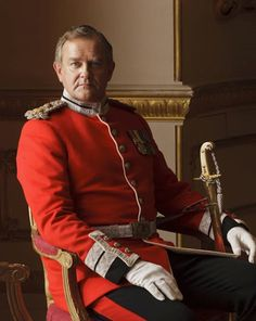 Downton Abbey's Lord Grantham (Hugh Bonneville) in his red military uniform.