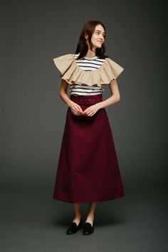 Bring on all the feminine frills! Monica Paolini and Sean Monahan, of Sea, are feeding my current obsession with ruffles with exaggerated bell sleeves, eyelet frills and puffy sleeves in crisp white cotton. I love how stripes are subtly incorporated into a basic color palette that includes ochre,