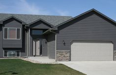 This dark gray siding with wide white trim would look very sharp.
