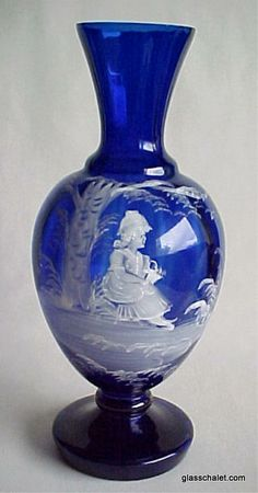 Beautiful Mary Gregory hand painted cobalt blue vase with lady in garden.