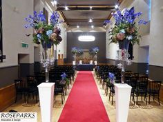 Wedding ceremony aisle decorations in Queen Anne Room at Edinburgh Castle