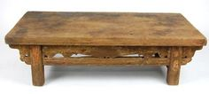 This hand carved Antique Low Table, made of Northern Chinese Elm Wood, shows simplicity at its finest, and at over 100 years old, is still an eye catching piece.