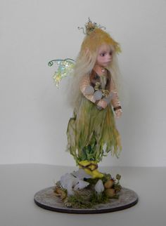 This is Angelica - one of my fairies sculpted from polymer clay.  She is approx 14cm tall.  Her dress is made from hand dyed silk and her little waistcoat is leather.