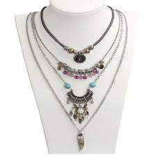 Four multilayer bohemian acrylic necklace Brand new. PLEASE NOTE: these are 4 different necklaces. They create a multilayer effect as they are all different lengths.                                                       Please refer to the 4th pic for necklace lengths. You can wear them individually or all together. It gives you more choices Material: acrylic, Metal: zinc alloy Jewelry Necklaces