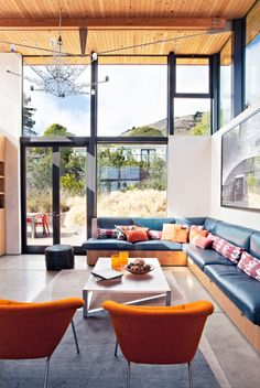 Wood paneled ceiling, beautiful modern great room. Sustainable modern property: Stinson Beach House