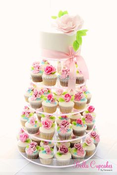 A wedding cupcake tower created by Bella Cupcakes.