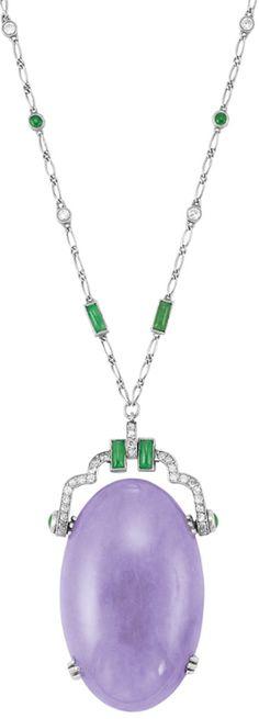 Art Deco Platinum, Lavender Jade, Jade and Diamond Pendant-Necklace.  One oval lavender jade ap. 41.0 x 25.0 x 7.8 mm., c. 1920. Length 18 1/4 inches. Via Doyle New York.