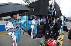 The pit crew of NASCAR Sprint Cup Series driver Aric Almirola