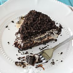 This frozen Mississippi mud pie starts with a cookie crust and then layered with hot fudge, creamy coffee ice cream and more crused oreos.