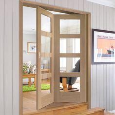 Bespoke Thrufold Shaker Oak 4L Glazed Folding 2+0 Door - Lifestyle Image.    #oakglazeddoor #glazedfoldingdoor