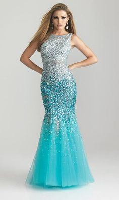 All-over beaded mermaid shaped evening gown with sheer illusion neckline and dramatic scooped back.