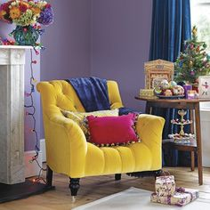 I LOVE this big yellow comfy chair! Would go great in a grey room