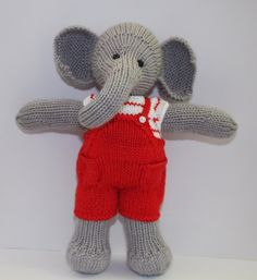 Hand knitted Elephant wearing cute little dungarees and striped top Hand knitted Elephant wearing cute little dungarees and striped top by Nodnook on Etsy Always wanted to learn to knit, b. Best Christmas Presents, A Christmas Story, Debbie Bliss Yarn, Little Cotton Rabbits, Pretty Packaging, Etsy Uk, Knitting For Beginners, Dungarees, Little Red