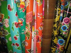 More oilcloth examples.  I tend to like the vintage and wildly floral fabrics, as well as some crazy patterns.  They are fun pops of color and whimsy!
