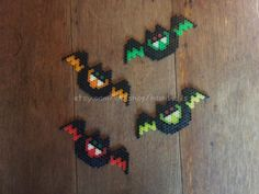 Individual Halloween themed Bat made from hama beads. Measures 5 1/2 by 2 1/4 inches. Perfect for decorating your home this Halloween, giving out