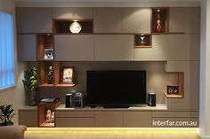 Wall Units | Interfar - Residential - Custom floor to ceiling Wall unit/entertainment unit with timber veneer open displays and feature lignting