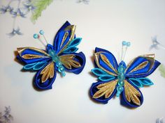 Butterfly with gold and royal blue wings. Set of 2 by Stephaana