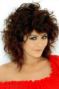26. Curly Hairstyle with Bangs 2017