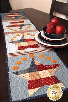 Patchwork Patriotic Table Runner Kit: Add some Americana to your summer table! This quick and easy table runner project features small wool felt stars around larger patchwork stars. Kit includes pattern and all fabrics including wool felt, binding and backing. Finished size of 12 1/2