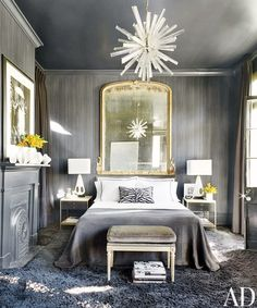 Gray bedroom with gold and white accents