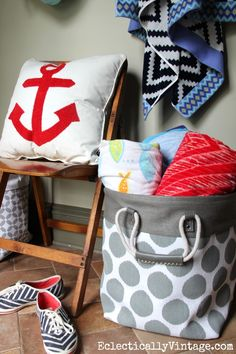 What a cute summer mudroom with great storage ideas - and I love that HomeGoods anchor pillow and canvas basket for storing beach towels! #HappybyDesign #HomeGoodsHappy #sponsored eclecticallyvintage.com