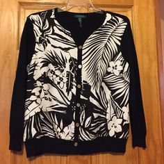 Ralph Lauren Floral Sweater. The front of the sweater is 100% silk. It has a beautiful floral design in the front and silk and cashmere sweater backing. It has gold buttons going down the front. It is in great condition. Size XL Ralph Lauren Sweaters