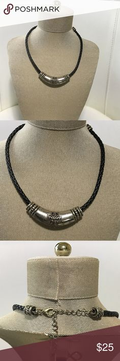 Leather Black Necklace This necklace comes with highly durable leather and is In great condition. It has a silver piece with a cross on both sides. Jewelry Necklaces