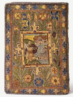 Tapestries called Sheldon -   Tapestry covered Bible  (tapestry is a form of weaving)