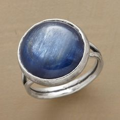 END OF THE TUNNEL RING -- In this hammered blue kyanite ring, inky stone reveals hopeful glimpses of white light within. Sundance exclusive on a split, hammered sterling silver band. Whole sizes 5 to 9.