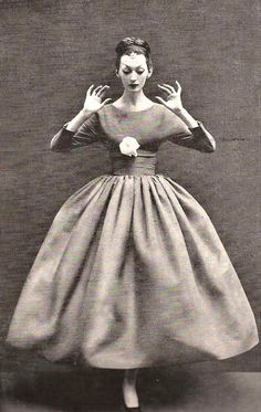 Dovima wearing a dress by Balenciaga for Harper's Bazaar, October 1955. Photo by Richard Avedon.
