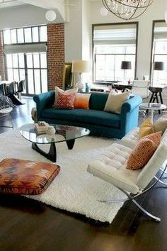 Barcelona Chairs, Noguchi Coffee Table with Orange and Teal Color Scheme - styled by Madison Modern Home